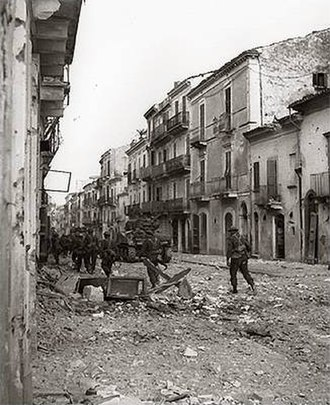 1st Canadian Division - Infantrymen of the Loyal Edmonton Regiment and tanks from the Three Rivers Regiment during the Battle for Ortona, December 1943.