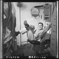 Lt. Wayne Miller relaxes in his quarters on the USS Ticonderoga (CV-14). - NARA - 520842.tif