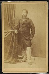 Lunalilo standing with cane, cabinet card photograph by Henry L. Chase.jpg