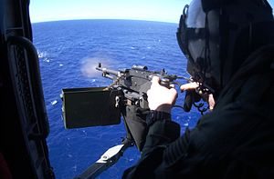 "HSC-8 - M240 machine gun is fired from a SH-60F Sea Hawk assigned to the ""Eightballers"" of Helicopter Anti-Submarine Squadron Eight (HS-8) during a training exercise. 2003"