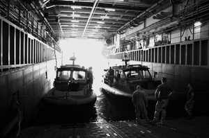 Maritime Expeditionary Security Force -  An Inshore Boat Units MESF boats docked onboard another vessel in the Northern Persian Gulf, July 2009