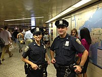 Two members of the MTA Police in Penn Station.