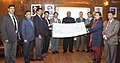 Mallikarjun Kharge receiving the cheques of Rs. 11.77 crore for the year 2012-13 from the Director Finance (looking after as C&MD) of IRCTC, Shri M.P. Mall, in New Delhi on January 28, 2014.jpg