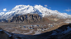 Manang - Manang village. Annapurna-III (left, 7555 m) and Gangapurna (7455 m) peaks are in the background.