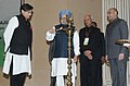 Manmohan Singh lighting the lamp to inaugurate the Diamond Jubilee celebrations of the University Grants Commission, in New Delhi. The Union Minister for Human Resource Development, Dr. M.M. Pallam Raju.jpg