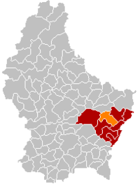 Map of Luxembourg with Biwer highlighted in orange, the district in dark grey, and the canton in dark red