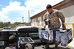 Marine corpsman assists with housing efforts at GTMO 130701-Z-FT114-001.jpg