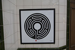 Mark Wallinger Labyrinth 250 - Barons Court.jpg
