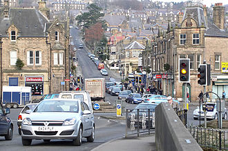 Matlock, Derbyshire - Matlock taken from Matlock Bridge - looking up the hill of Bank Road across Crown Square (prior to bridge one way system).