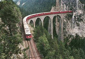 Rail transport in Switzerland - A Ge 6/6 <sup>II</sup> on the Albula Railway crossing the Landwasser Viaduct between Schmitten and Filisur