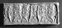 Mitannian - Cylinder Seal with Two Heroes and a Tree - Walters 42992 - Impression.jpg
