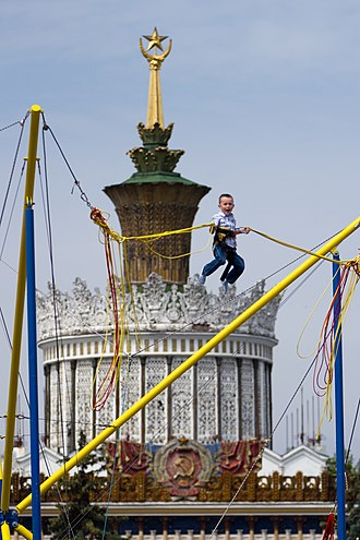 Bungee cord - A child on a bungee cord device in Moscow, Russia