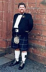 Kilt worn with the less formal Argyll jacket, and belt.