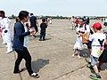 Mother Photographing Family in Hukou Camp Ground after Program 20140329.jpg