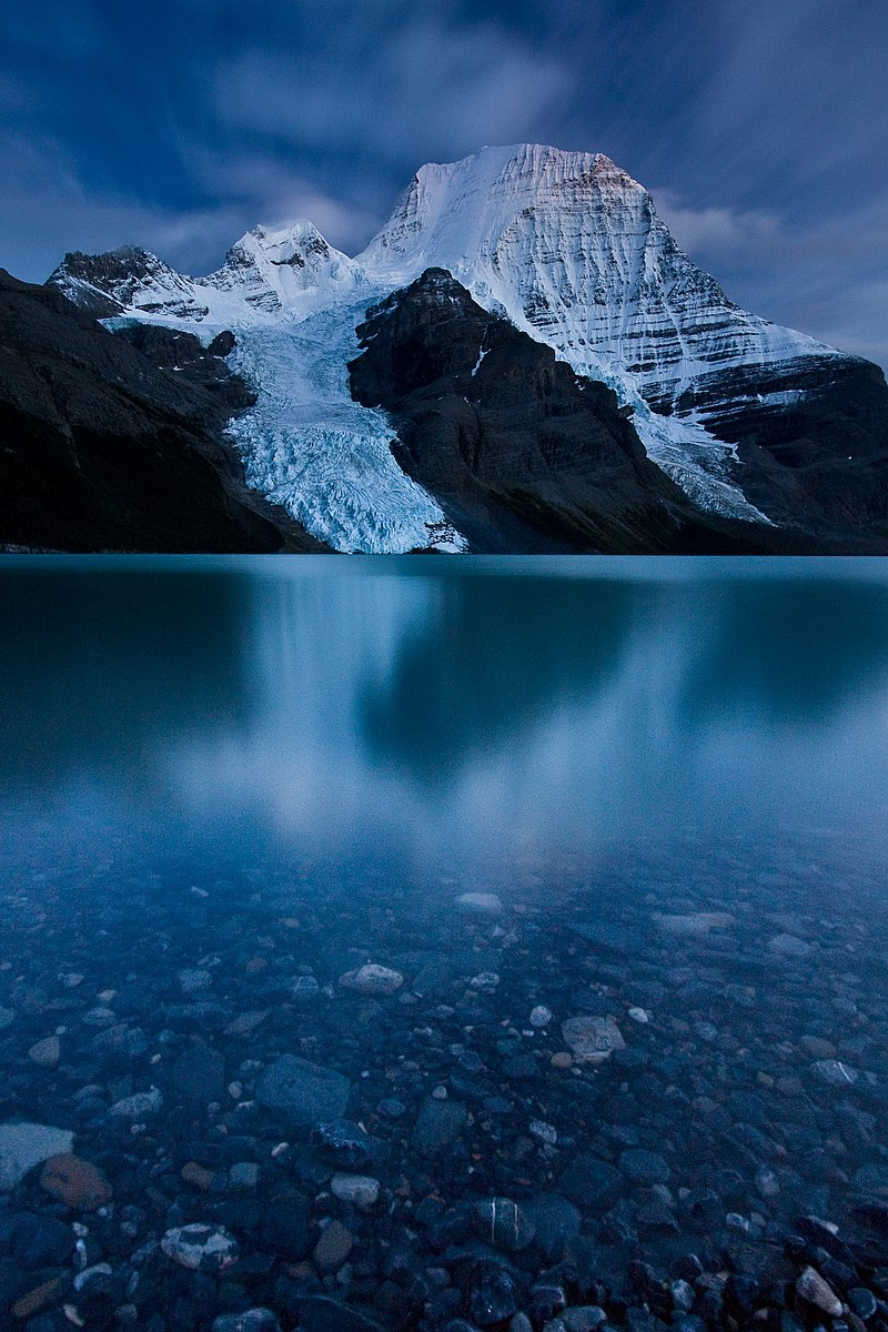 a snowy Mt Robson and clear Berg Lake in Mount Robson Provincial Park, Canada