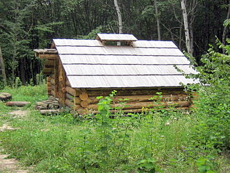 Log cabin - A timber cutter's mountain log cabin at the Museum of Folk Architecture, Pyrohiv, Ukraine.