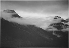 "Mountain partially covered with clouds, ""In Glacier National Park,"" Montana., 1933 - 1942 - NARA - 519860.tif"