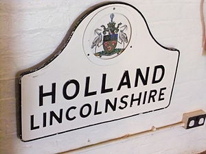 Parts of Holland - Holland sign on display at the Museum of Lincolnshire Life with the Latin motto Labor Ipse Merces (Work is its own reward)