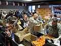 NYC Mayor and service members prepare care package for Pitt troops (5413445521).jpg