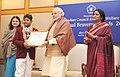 Narendra Modi presenting the National Bravery Awards 2015 to the children, in New Delhi on January 24, 2016. The Union Minister for Women and Child Development, Smt. Maneka Sanjay Gandhi is also seen (10).jpg