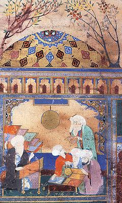 Насир ад-Дин Туси (сидит за столом) в Марагинской обсерватории. Миниатюра 1562 года. Британская библиотека