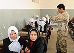 National Guardsmen distribute school supplies DVIDS342609.jpg