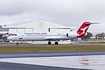 """Network Aviation (VH-NHP) Fokker 100, in new Qantaslink """"new roo"""" livery, taxiing at Wagga Wagga Airport (2).jpg"""