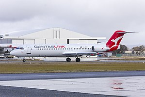 "Network Aviation (VH-NHP) Fokker 100, in new Qantaslink ""new roo"" livery, taxiing at Wagga Wagga Airport (2).jpg"