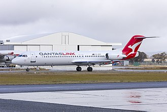 "QantasLink - Fokker 100 in the ""silver roo"" livery taxiing at Wagga Wagga Airport"
