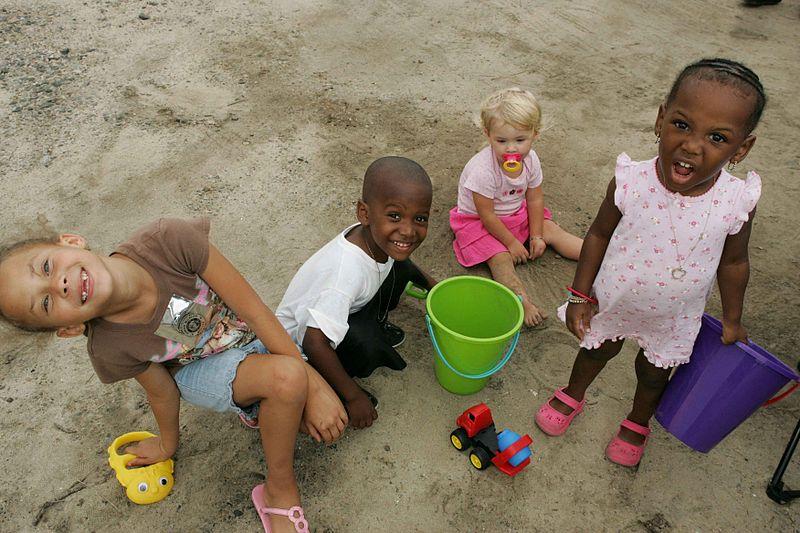 File:Nice sweet children playing in sand.jpg