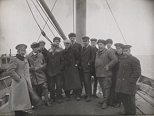 Northeast Passage - One of the pictures from Jonas Lied's and Nansen's journey to Siberia (2 August to 26 October 1913). Nansen is the tall man in the centre, number 2 from left hand is Loris-Melikov, number 5 partly concealed is Lied, number 10 is Vostrotin. Fridtjof Nansen started his trans-Siberian travel on a freighter from Oslo to Yenisei. The journey went through parts of the Northeast Passage, which was to be opened as a shorter trading connection between Western Europe and the Far East. The photograph depicts the encounter of some of the ship's crew with officers from the Russian barges at the mouth of the Yenisei River.