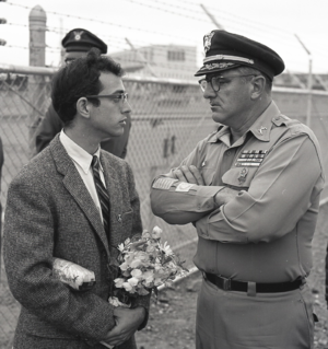 Harvey Richards - A Non-Violent Confrontation. June 1965, Oakland Army Base. Committee for Non-Violent Action offers gifts to soldiers being deployed to Vietnam. Photo by Harvey Richards.