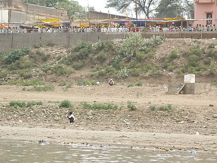 Many people defecate on the banks of the holy river. Above is the line to the temple. Photo by Yaniv Malz in mid 2008.