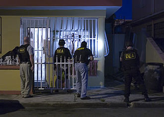 Police raid - Photo of a raid taking place as part of the United States Drug Enforcement Administration's Operation Mallorca