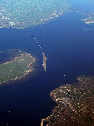 Øresund Bridge - Aerial photo of Øresund Bridge. In the foreground is Copenhagen Airport on the island of Amager, to the left of the bridge is the Danish island of Saltholm, and in the background, the bridge connects to Malmö.