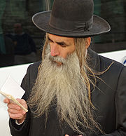 Orthodox Jew in Jerusalem with a beard and trimmed payot (sidelocks).