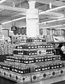 Overall view and medication display (Micrin oral antiseptic) at Clark's, a grocery, drug, sundries, and department store and lunch counter, 3900 North Independence Boulevard, Charlotte, NC, c.1962 or (6876070803).jpg