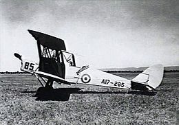 Single-engined military biplane parked on airfield