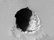Pavonis Mons eastern flank lava tube skylight crop sharp