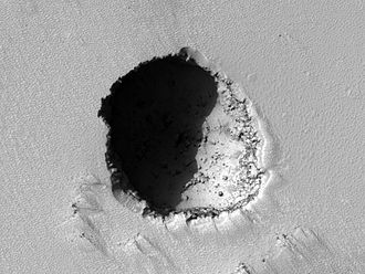 Caves of Mars Project - Image: Pavonis Mons eastern flank lava tube skylight crop sharp