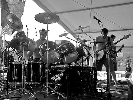 Pelican, also instrumental, diverge from heavy metal conventions in all aspects of their style and approach. Pelican performing at Sant Feliu Fest 2004.jpg