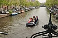 People in boat canal Amsterdam party 2011.jpg