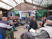 Group at permaculture convergence listen to Andy Goldring