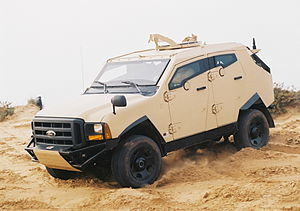 Vehicle armour - Plasan Sand Cat light (5t) military vehicle featuring integrated composite armoured body