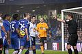Players confront referee Michael Jones - Chelsea vs Bolton Wanderers.jpg