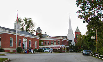 Plymouth, New Hampshire - Town center (left to right): Plymouth Post Office, Rounds Hall of Plymouth State University (in background), Plymouth Congregational Church, Town Hall