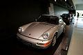 Porsche 911 1989 Carrera 4 3.6 Coupè LSideFront PorscheM 9June2013 (15012276032).jpg