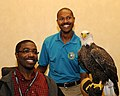Posing for picture with Bald Eagle. (10594250963).jpg