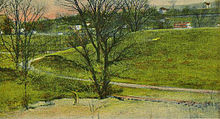 An old postcard showing a large green earthen dam with a small stream flowing in front. There are bare trees in front and houses on a hillside in the background