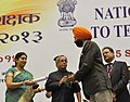 Pranab Mukherjee presenting the National Award for Teachers-2013 to Shri Jasvinder Singh, Punjab, on the occasion of the 'Teachers Day', in New Delhi. The Union Minister for Human Resource Development.jpg